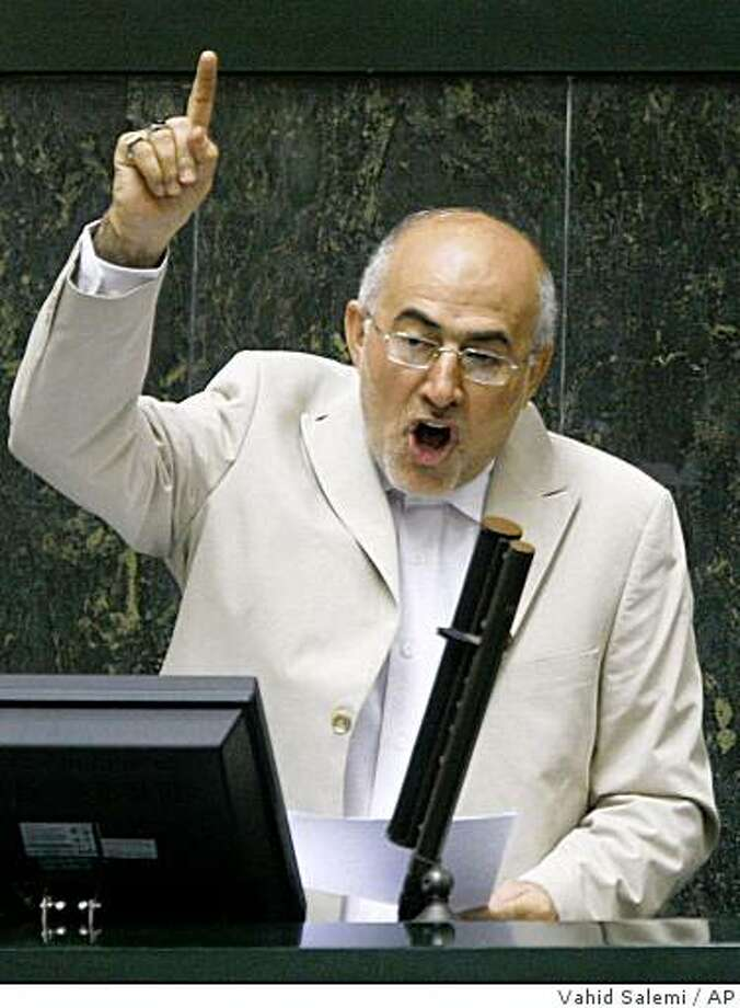 Iranian Interior Minister Ali Kordan delivers a speech, prior to a vote by members of parliament to impeach him, during an open session of parliament, in Tehran, Iran, Tuesday, Nov. 4, 2008. Iran's parliament impeached the country's interior minister for deception Tuesday in a vote widely seen as a defeat for hard-line President Mahmoud Ahmadinejad. Parliament's no-confidence vote for Ali Kordan comes after he admitted he had a fake degree from Oxford University. (AP Photo/Vahid Salemi) Photo: Vahid Salemi, AP