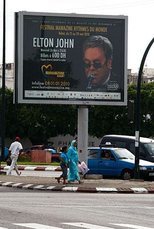 Poster  of British singer and composer Elton John  in the street of Rabat, Morocco, Wednesday May 26, 2010. Elton John was expected to be the highlight of Morocco's biggest music festival Wednesday evening, despite calls by the country's main Islamist party to shelve the British singer because of his homosexuality. Photo: Abdeljalil Bounhar, Associated Press