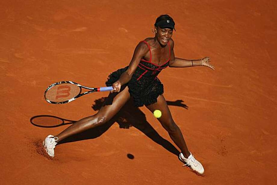 PARIS - MAY 23:  Venus Williams of the United States plays a forehand during the women's singles first round match between Venus Williams of the United States and Patty Schnyder of Switzerland on day one of the French Open at Roland Garros on May 23, 2010in Paris, France. Photo: Julian Finney, Getty Images