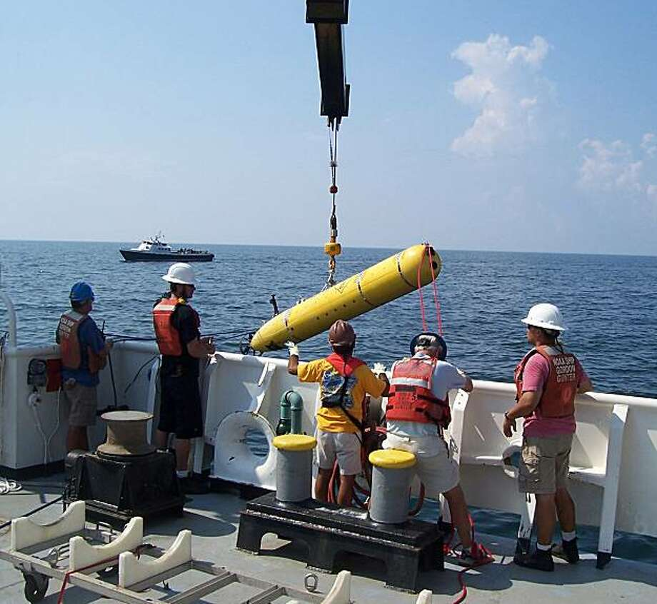 An autonomous underwater vehicle from the Monterey Bay Aquarium Research Institute (MBARI) being launched from the NOAA Ship Gordon Gunter in the Gulf of Mexico. Photo: Yanwu Zhang, MBARI
