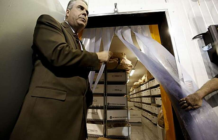 Assistant San Francisco police chief Jeff Godown displays the boxes of perishable evidence, such as DNA, being stored inside a cold locker, on Thursday Apr.8, 2010, inside the crime lab evidence warehouse in San Francisco, Calif. Photo: Michael Macor, The Chronicle