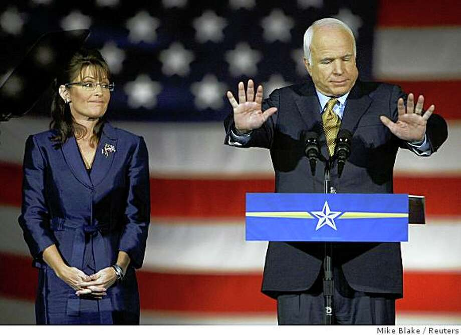 U.S Republican presidential nominee Senator John McCain speaks to the crowd during his election night rally in Phoenix, November 4, 2008. Joining McCain is U.S. Republican vice presidential nominee Alaska Gov. Sarah Palin. Photo: Mike Blake, Reuters