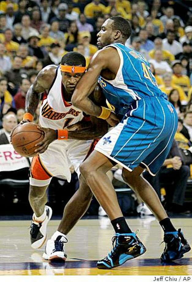 Golden State Warriors guard Stephen Jackson, left, drives on New Orleans Hornets forward Rasual Butler in the second quarter of an NBA basketball game on Wednesday, Oct. 29, 2008, in Oakland, Calif. (AP Photo/Jeff Chiu) Photo: Jeff Chiu, AP