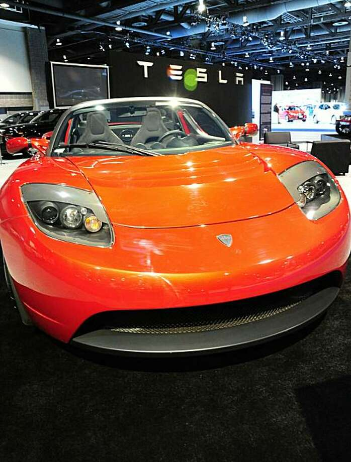 (FILES)The Tesla Roadster Hybrid car on display at the Washington Auto Show on February 4, 2009 in Washington, DC. US electric carmaker Tesla Motors is firing on all cylinders and gearing up for greater things after partnering with top carmaker Toyota, before it goes public at some point down the road.Tesla, with just a few hundred employees, and Toyota late May 20, 2010 announced a 50-million-dollar stake by the Japanese carmaker in the small, Palo Alto, California-based firm. Photo: Karen Bleier, AFP/Getty Images