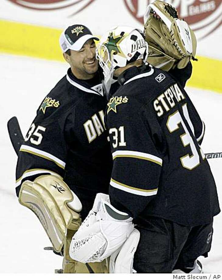 Dallas Stars goalie Tobias Stephan, right, of the Czech Republic, celebrates with teammate Marty Turco after an NHL hockey game against the Minnesota Wild, Wednesday, Oct. 29, 2008, in Dallas. Dallas won 4-2. (AP Photo/Matt Slocum) Photo: Matt Slocum, AP