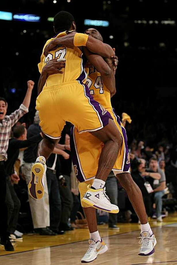 LOS ANGELES, CA - MAY 27:  Ron Artest #37 and Kobe Bryant #24 of the Los Angeles Lakers celebrate Artest's game winning shot against the Phoenix Suns in the fourth quarter of Game Five of the Western Conference Finals during the 2010 NBA Playoffs at Staples Center on May 27, 2010 in Los Angeles, California. Photo: Stephen Dunn, Getty Images