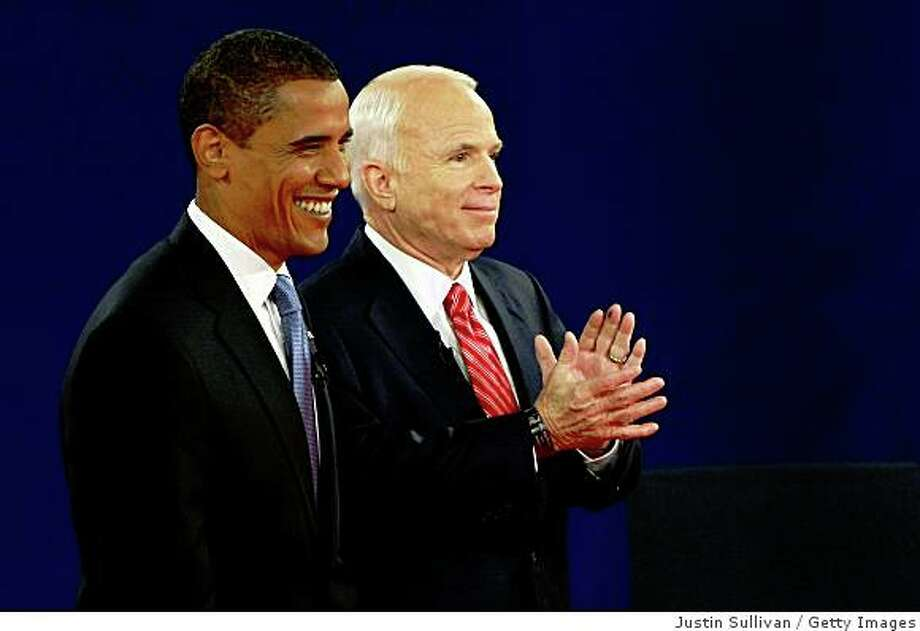 NASHVILLE, TN - OCTOBER 07:  Republican presidential candidate Sen. John McCain (R-AZ) (R) and Democratic presidential candidate Sen. Barack Obama (D-IL)  poses on stage after the Town Hall Presidential Debate at Belmont University's Curb Event Center October 7, 2008 in Nashville, Tennessee.   Tonight's debate is the second presidential debate of three, the only one being held in the town hall style with questions coming from audience members.  (Photo by Justin Sullivan/Getty Images) Photo: Justin Sullivan, Getty Images