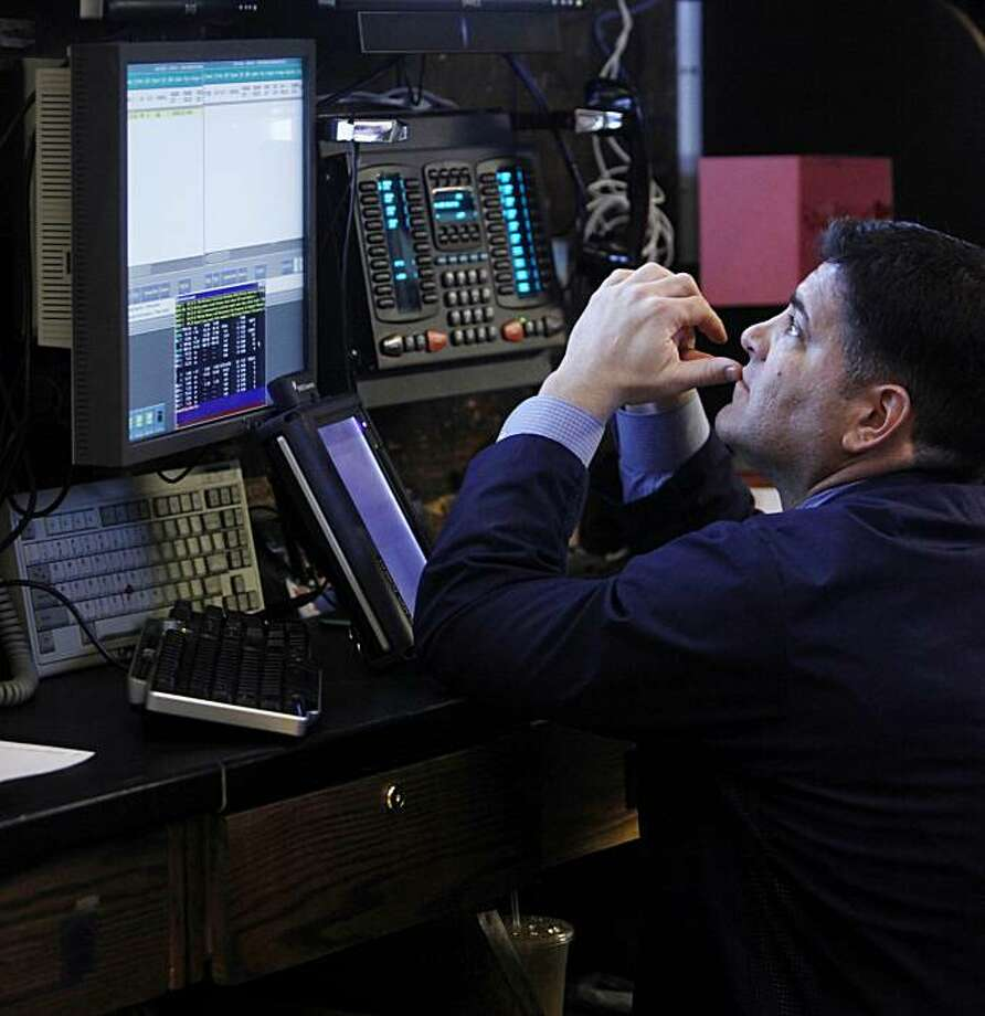 A traders works on the floor at the New York Stock Exchange in Thursday, May 27, 2010, in New York. Photo: Seth Wenig, AP