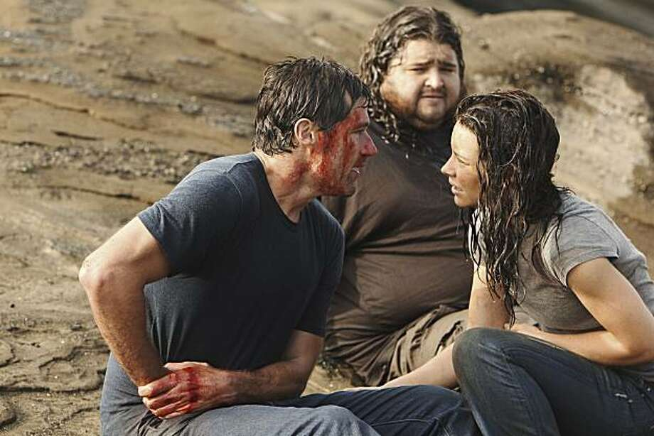 """In this publicity image released by ABC, Matthew Fox, left, Jorge Garcia and Evangeline Lilly, right are shown in a scene from the finale of """"Lost."""" Photo: Mario Perez, AP"""