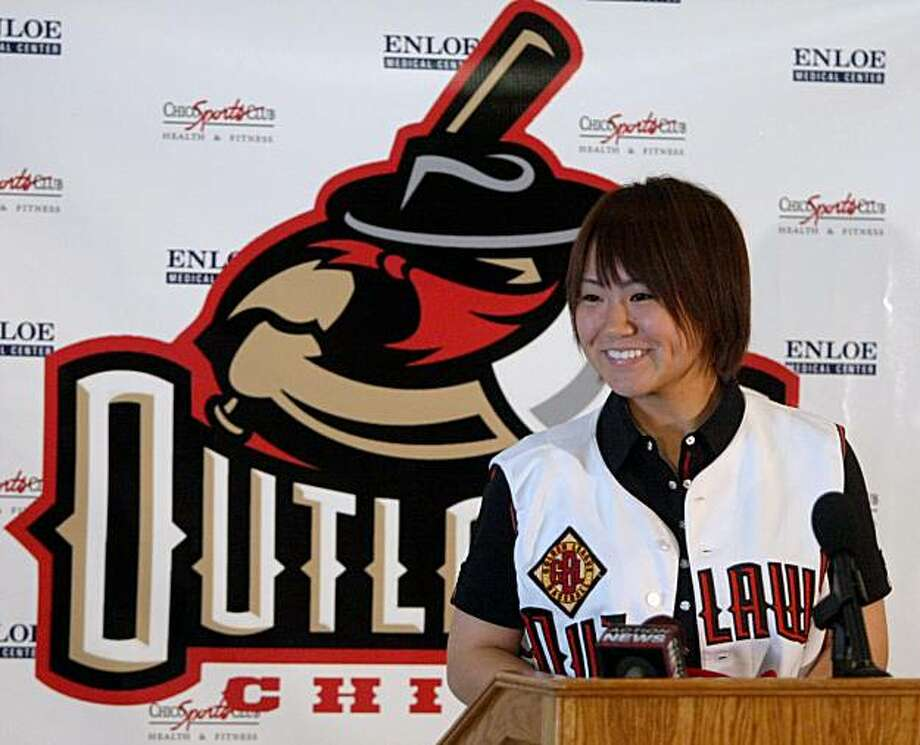 Knuckleball pitcher Eri Yoshida, of Japan, talks to the media at a minor league baseball news conference introducing her as a member of the Chico Outlaws at Chico Sports Club in Chico, Calif., on Friday, May 7, 2010. The news conference came less than twoweeks after Yoshida graduated from high school and only a few hours after she landed in San Francisco following a flight from Tokyo. Photo: Jason Halley, AP