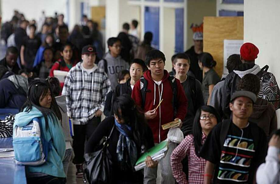 With the uncertainty of Measure looming over Alameda Schools, students walk through the halls at Encinal High School on Monday May 24, 2010 in Alameda, Calif. Measure E in Alameda would tax residents about $700 a year, and businesses up to $9,500 a year, for schools. If it fails, half the schools in Alameda would close. Photo: Mike Kepka, The Chronicle