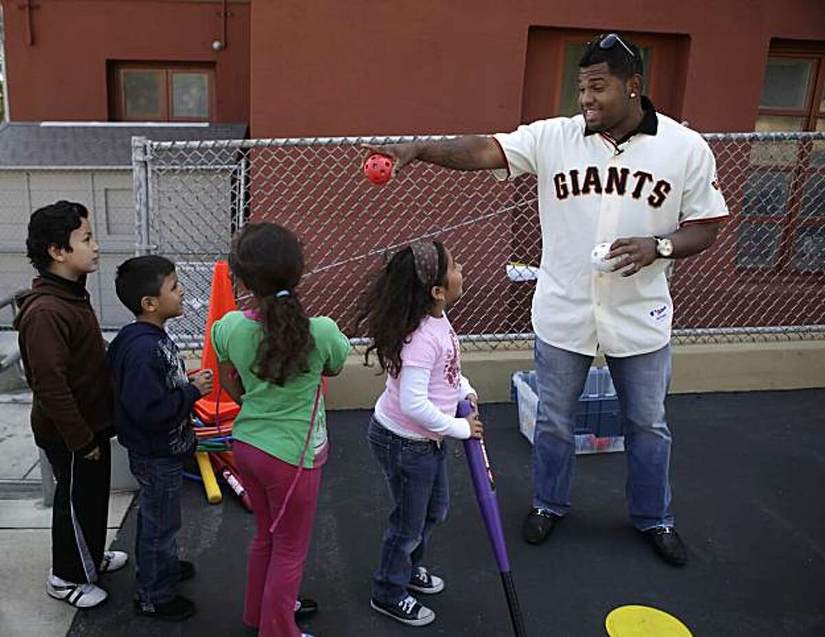 Giants' infielder Pablo Sandoval lines up children at the Mission Education Center before pitching to them. Sandoval appeared at the Mission Education Center in the first of a series of Operation Panda events encouraging kids to be active in the summer in San Francisco, Calif. on Wednesday May 26, 2010.