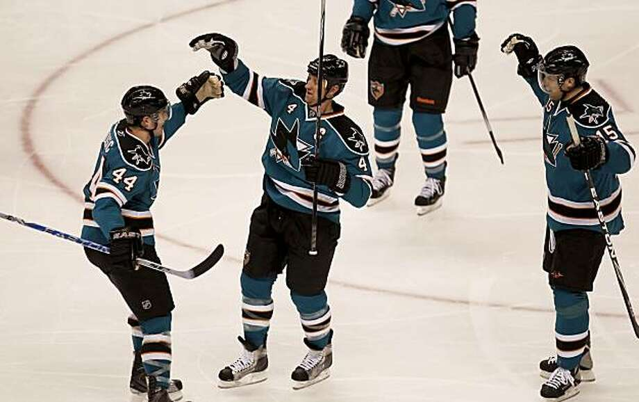 San Jose Sharks' Rob Blake celebrates his second period goal with teammates Marc-Edouard Vlasic and  Dany Heatley in the second period of the second game of the Western Conference Quarter Finals between the San Jose Sharks and the Colorado Avalanche in San Jose on Friday. Photo: Michael Macor, The Chronicle