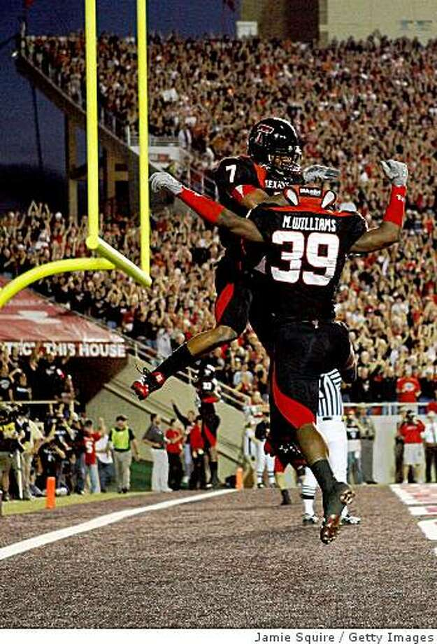 LUBBOCK, TX - NOVEMBER 01:  Darcel McBath #7 and Marlon Williams #39 of the Texas Tech Red Raiders celebrate after forcing a safety during the first half of the game against the Texas Longhorns on November 1, 2008 at Jones Stadium in Lubbock, Texas.  (Photo by Jamie Squire/Getty Images) Photo: Jamie Squire, Getty Images