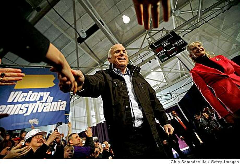 SCRANTON, PA - NOVEMBER 2:  Republican presidential nominee Sen. John McCain (R-AZ) (L) greets supporters with his wife Cindy McCain during a campaign rally at The Long John Center on the campus of the University of Scranton November 2, 2008 in Scranton, Pennsylvania. With less than three days before the U.S. presidential election, McCain campaigned in the all-important swing states of Pennsylvania, New Hampshire and Florida.  (Photo by Chip Somodevilla/Getty Images) Photo: Chip Somodevilla, Getty Images