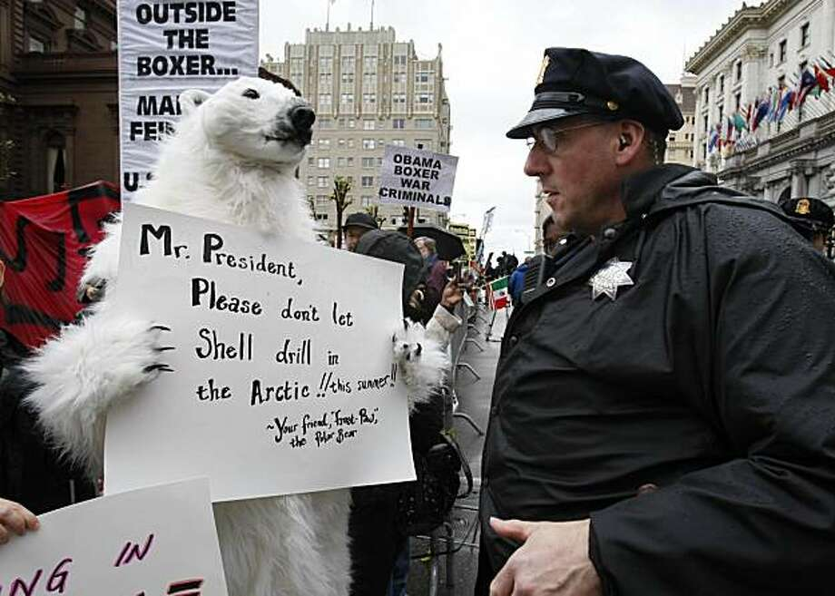 A demonstrator in a polar bear outfit talks to a police officer in San Francisco, Tuesday, May 25, 2010, in front of a hotel where President Obama plans to attend for a fund-raising campaign for Sen. Barbara Boxer, D-Calif. Photo: Paul Sakuma, AP