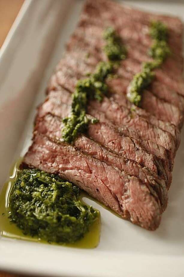 Steak With Salsa Verde: For best results, cook the meat medium-rate and slice thinly. Click here for the recipe. Photo: Craig Lee, Special To The Chronicle