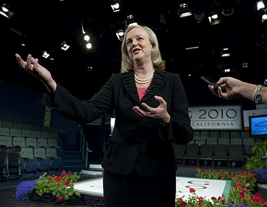 Meg Whitman, speaks to the media after a town hall meeting were she spoke about the Governor's May revisions at the Tower Theatre in Roseville on Monday, May 17, 2010. (AP Photo/The Sacramento Bee, Hector Amezcua) MAGS OUT, TV OUT, MANDATORY CREDIT Photo: Hector Amezcua, AP