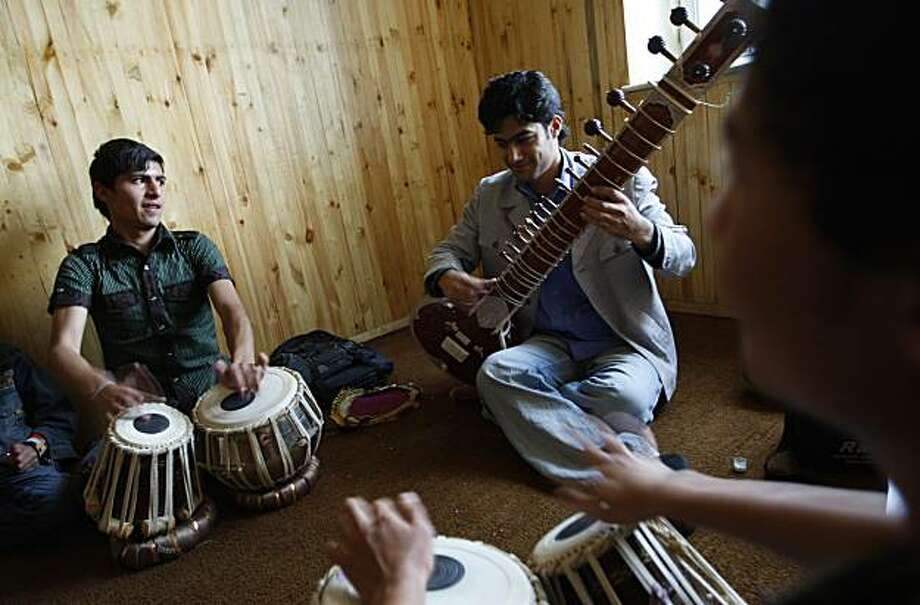 ** ADVANCE FOR SUNDAY, MAY 16 ** Students play music at the National Institute of Music in Kabul, Afghanistan, Wednesday, May 11, 2010. In this city where music was illegal less than a decade ago, a new generation of children is being raised to understandits joys. Photo: Saurabh Das, AP