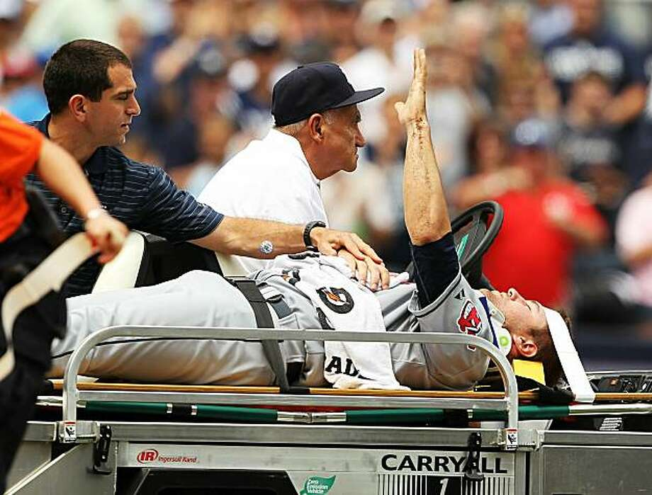 NEW YORK - MAY 29:  Cleveland Indians starting pitcher David Huff #28 waves to the crowd in a stretcher after Alex Rodriguez #13 of the New York Yankees hit him in the head with a line drive during the third inning of their game on May 29, 2010 at YankeeStadium in the Bronx borough of New York City. Photo: Al Bello, Getty Images