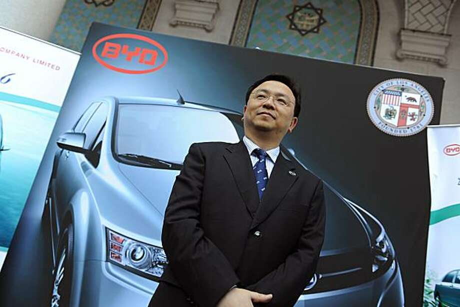 BYD Chairman Wang Chuanfu  poses in front of a photo of BYD's e6 electric car at a press conference April 30, 2010 at Los Angeles City Hall to announce that  the Chinese solar energy and automobile firm BYD will locate its US headquarters in Los Angeles,CA potentially creating hundreds of new jobs. BYD, which stands for Build Your Dreams, is a manufacturer of batteries, solar panels and electric-hybrid vehicles partly financed by billionaire Warren Buffett.   BYD plans to introduce the e6 in China and the US later this year. Photo: Robyn Beck, AFP/Getty Images