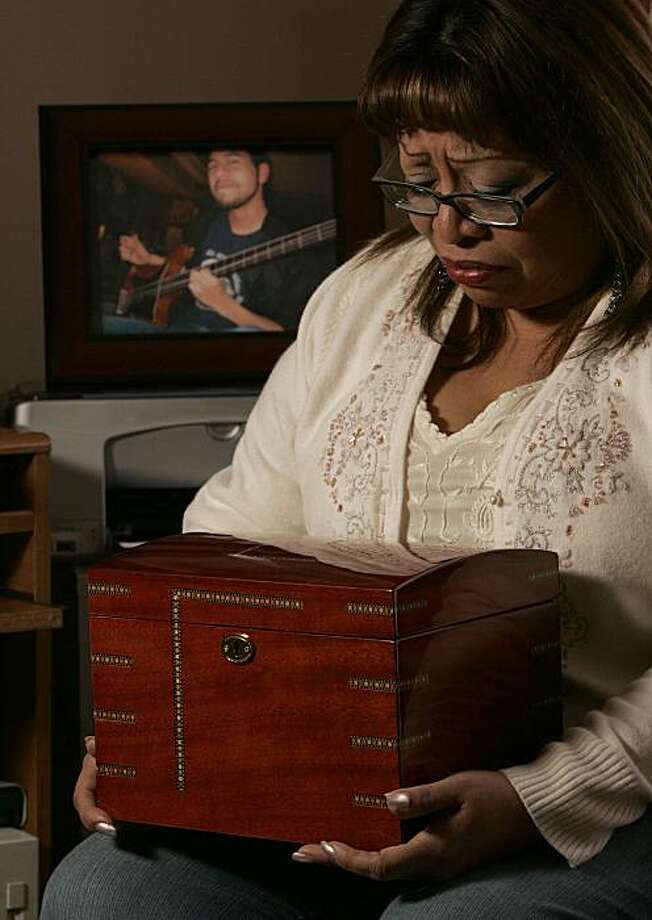 Selina Picon, holds the wooden urn that contains her son's heart, returned by the coroner.  Selina has never opened the box, she  keeps the box under her bed.  Their son's death, from a rare heart defect, was the first shock for Joe and Selina Picon.  the second was her discovery that the San Mateo County coroner had kept the heart of their 23 year old son, Nick, without notifying her, which  is allowed by state law.  After raising a big fuss, the coroner returned the heart to her and now the County Supervisors are working to change the law on the statewide level. Photo: Michael Macor, The Chronicle