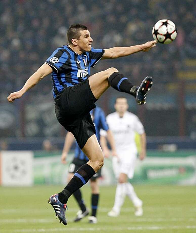 Inter Milan Brazilian defender Lucio controls the ball during a Champions League, round of 16, first leg soccer match between Inter Milan and Chelsea at the San Siro stadium in Milan, Italy, Wednesday, Feb. 24, 2010. Photo: Antonio Calanni, AP