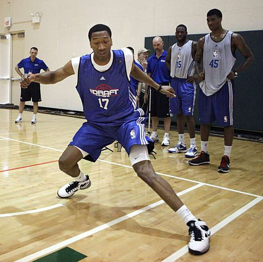 Syracuse's Wesley Johnson participates at the lane shuffle station at the NBA Draft Combine basketball workout Friday, May 21, 2010,  in Chicago. Photo: Charles Rex Arbogast, AP