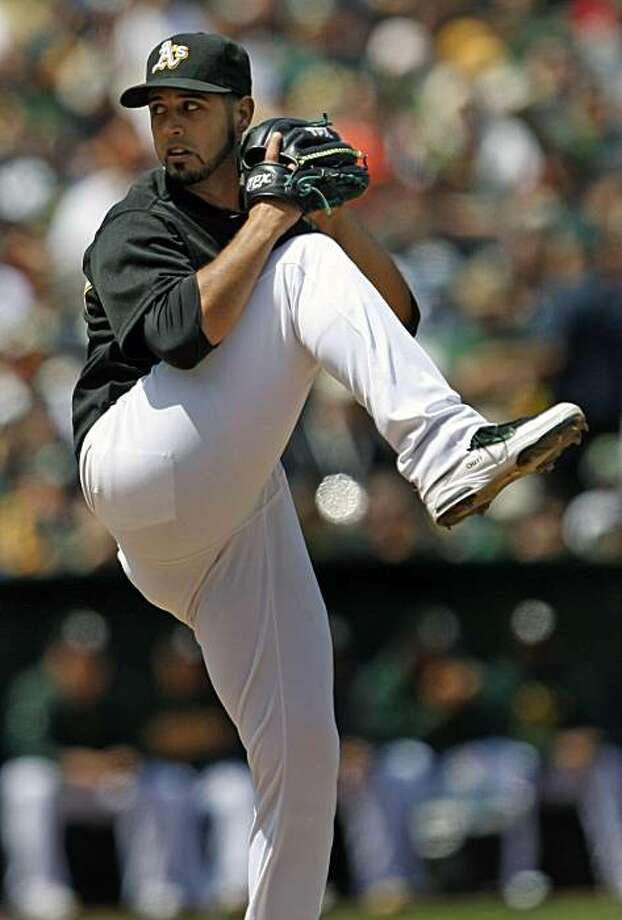 Athletics pitcher Gio Gonzalez works against the San Francisco Giants in the seventh inning Saturday in Oakland. Photo: Lance Iversen, The Chronicle