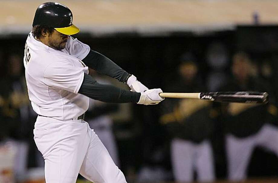 Oakland Athletics' Coco Crisp hits an RBI-double off of San Francisco Giants' Barry Zito during the seventh inning of a baseball game in Oakland, Calif., Friday, May 21, 2010. Photo: Jeff Chiu, AP