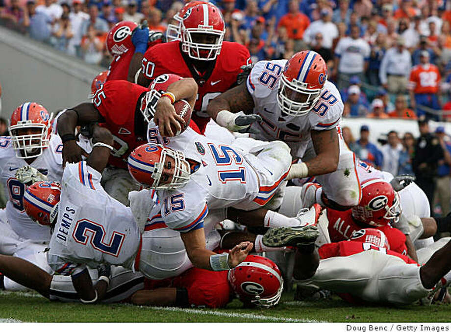 JACKSONVILLE, FL - NOVEMBER 01:  Quarterback Tim Tebow #15 of the Florida Gators dives in for a touchdown in the second quarter while taking on the Georgia Bulldogs at Jacksonville Municipal Stadium on November 1, 2008 in Jacksonville, Florida.  (Photo by Doug Benc/Getty Images) Photo: Doug Benc, Getty Images