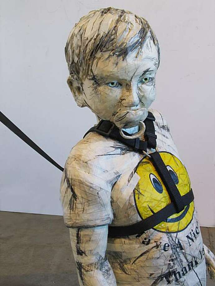Rune Olsen's sculpture of a boy: 37 x 18 x 13 inches + Leash: 44 inch Medium: Graphite, masking tape, blue mannequin eyes, newspaper, wire,  steel and UV-Resistant acrylic medium + plastic bag, leash, and 24K  gold Image detail Photo: Courtesy Rune Olsen