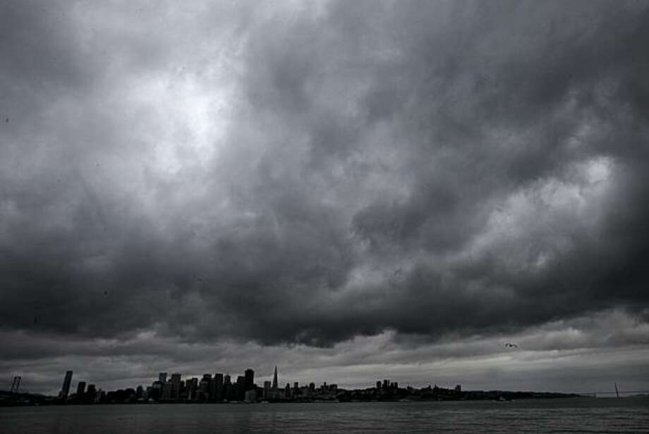 A view from Treasure Island of San Francisco between the bridges on a dark and wet day Tuesday. Photo: Brant Ward, The Chronicle