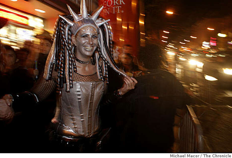 """Sunshine Schmidt of San Francisco with her costume, """"Cyberty"""" lady Liberty from outer space, during Halloween night in the Castro District of San Francisco, Calif., on Friday, Oct. 31, 2008. Photo: Michael Macor, The Chronicle"""