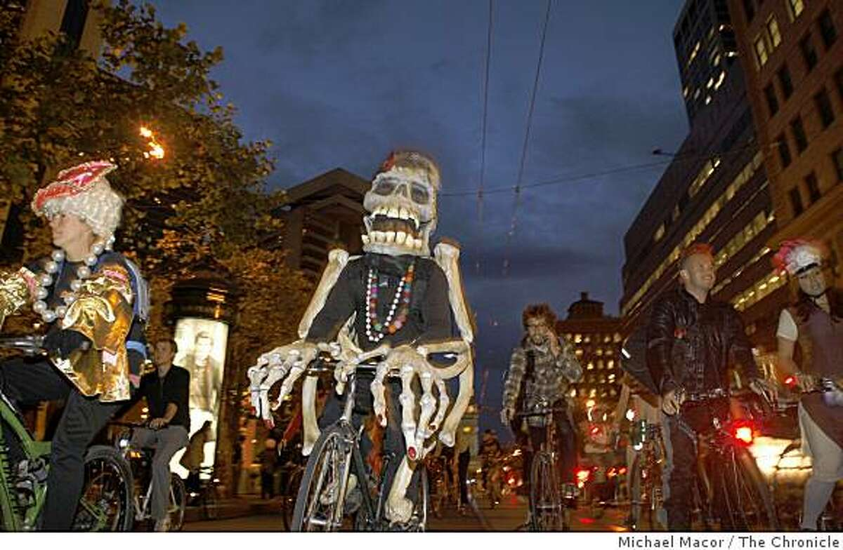 Costumed riders pedal down Market Street in costume as bicycle activists join the monthy Critical Mass event down the streets of San Francisco, Calif. on Friday Oct. 31, 2008, Halloween evening. Skelton is Andres Rojo of San Francisco.
