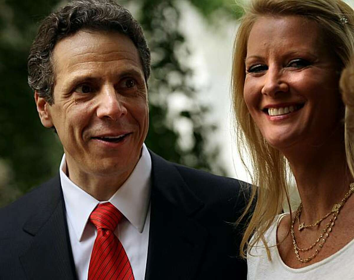 NEW YORK - MAY 22: New York Attorney General Andrew Cuomo stands on stage in the park with his girlfriend, Food Network host Sandra Lee, following his announcement to supporters that he is officially running for the Governor of New York outside the TweedCourthouse on May 22, 2010 in New York City. For eleven years Cuomo's father, Mario, was the fifty-second Governor of the state.