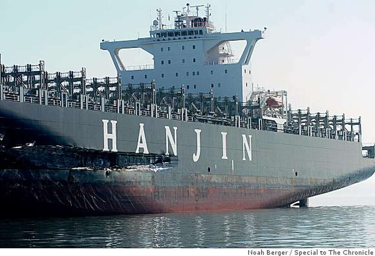 An approximately 90-foot long gash stretches down the Cosco Busan's hull as it rests at anchor on Tuesday, Nov. 13, 2007, in the San Francisco Bay, Calif.