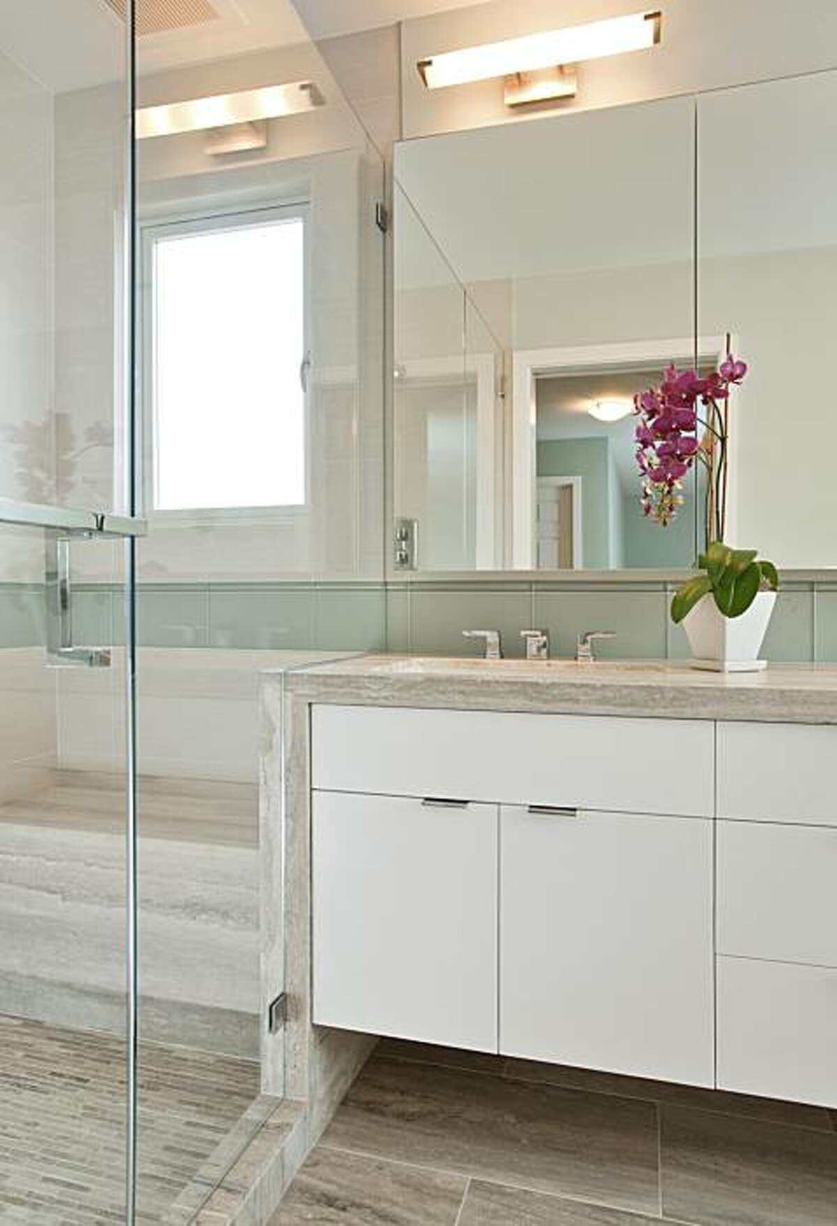 Removing the wall that awkwardly separated the main components of this Oakland master bath, allowed Rochelle Silberman to create a much more efficient layout.