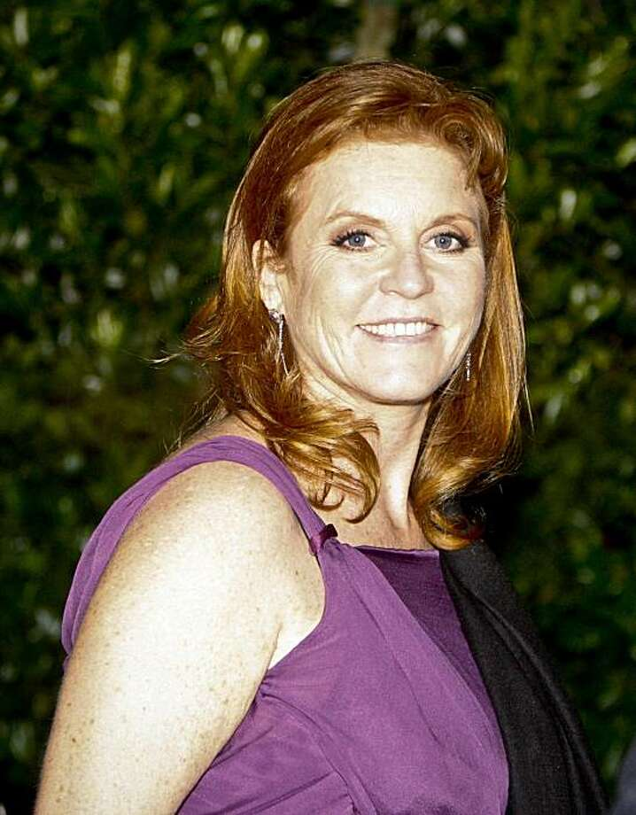 Duchess of York Sarah Ferguson leaves the Renaissance Hotel after receiving an award during the Variety International dinner at the 2010 Hollywood World Conference, Sunday, May 23, 2010, in Los Angeles, Calif. Britain is collectively shaking its head at the latest gaffe by Sarah Ferguson, the Duchess of York, who was recorded apparently offering to sell access to her ex-husband Prince Andrew in return for a half-million pounds ($725,000.) Photo: Bret Hartman, AP