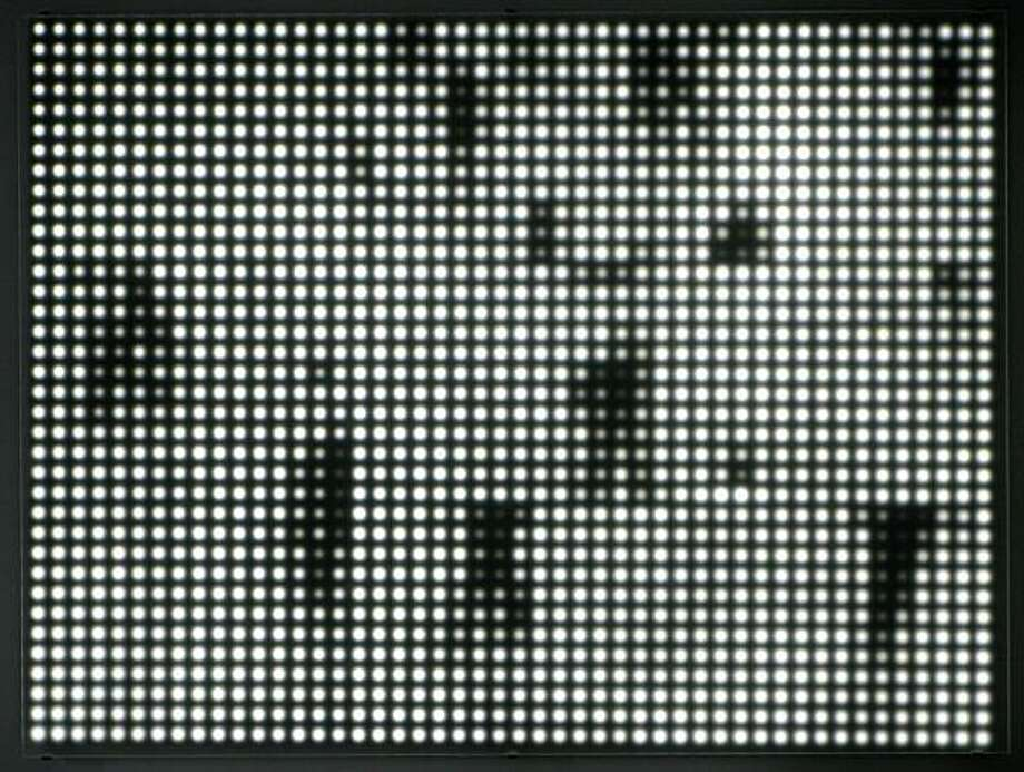 """""""Grand Central Station 4"""" (2010) LEDs, Duratrans on Plexiglas and custom electronics by Jim Campbell   33"""" x 44"""" x 2"""" Photo: Courtesy, Hosfelt Gallery, S.F."""