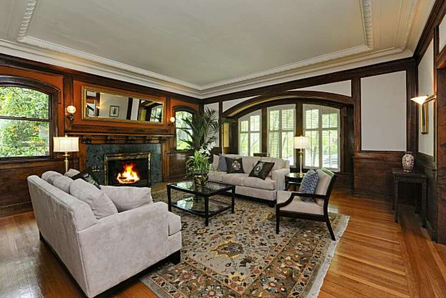 The home's formal living room includes a fireplace. A Gold Coast Tudor Revival property, 1200 San Antonio Avenue was built in 1910 and spans 6,493 square feet. Photo: Thomas Grubba Photography