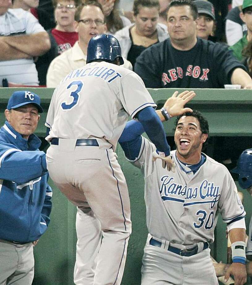Kansas City Royals' Yuniesky Betancourt (3) celebrates his grand slam with teammate Mike Aviles (30) in the fourth inning of a baseball game against the Boston Red Sox, Friday, May 28, 2010, in Boston. Photo: Michael Dwyer, AP