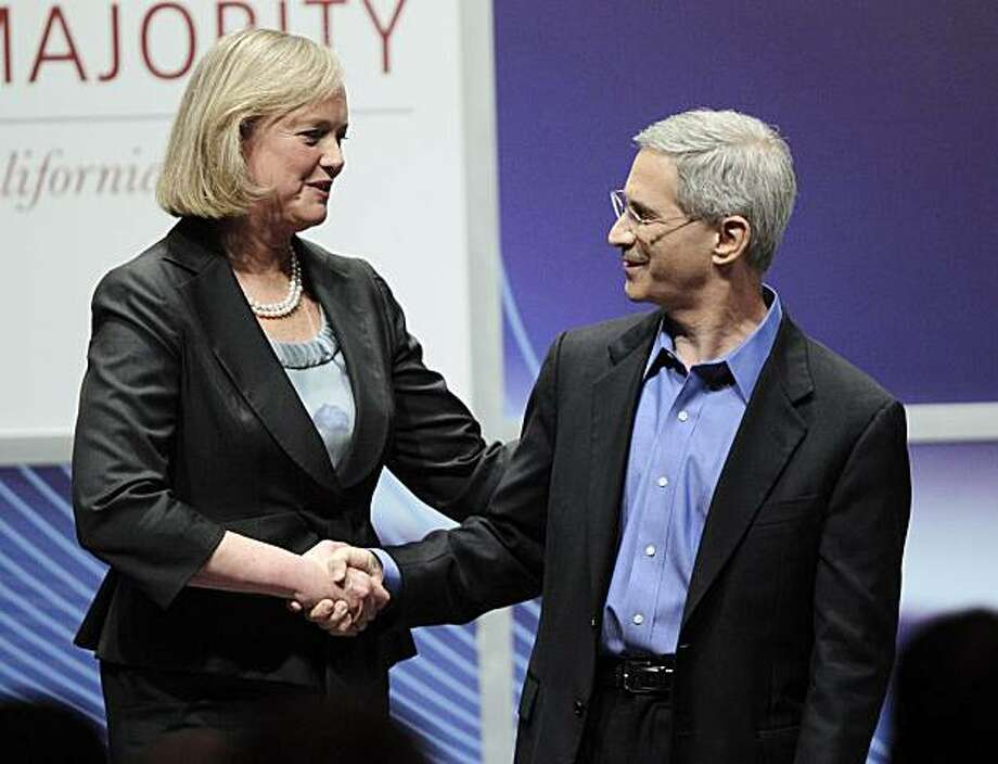 Former eBay executive Meg Whitman. left, and California Insurance Commissioner Steve Poizner shake hands after their debate for the California Republican gubernatorial primary Monday in Costa Mesa. Photo: Jae C. Hong, AP