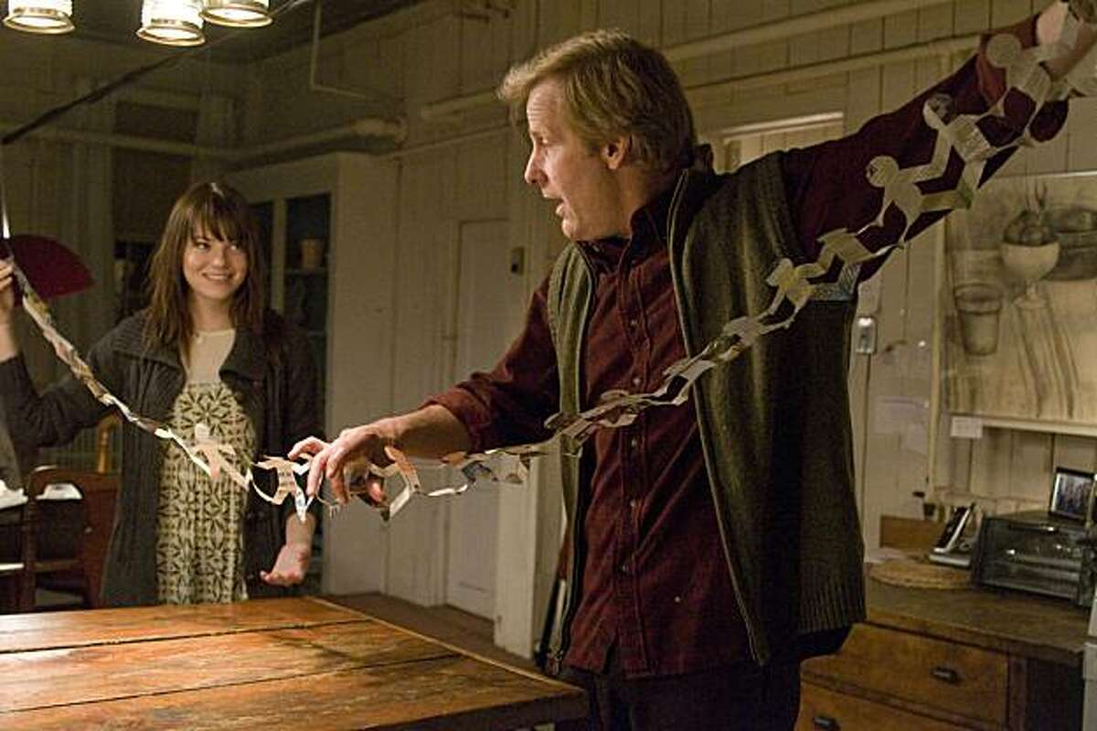 Jeff Daniels and Emma Stone appear in a scene from,