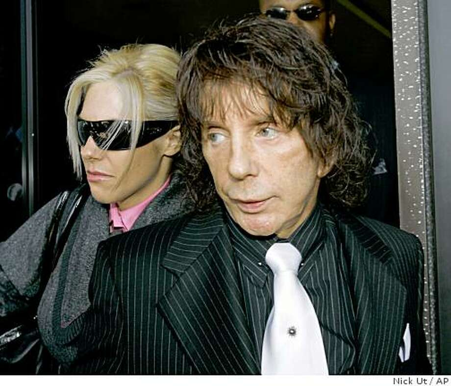 Music producer Phil Spector and his wife Rachelle leave the Los Angeles Country Superior Court Wednesday, Oct. 29, 2008, for a lunch break during his murder retrial. Spector is accused of killing actress Lana Clarkson at his home in 2003. (AP Photo/Nick Ut) Photo: Nick Ut, AP