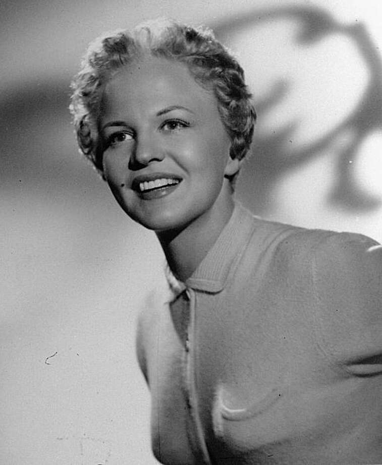 "FILE- This is an undated file photo of singer Peggy Lee. Perhaps best known for her smooth, sultry 1958 cover of the rhythm-and-blues hit ""Fever,"" the late pop-jazz singer, songwriter and actress has returned to the ""Billboard"" Top 200 album chart hit for the first time since 1970.  Lee died in 2002. (AP File Photo) NO SALES Photo: AP"
