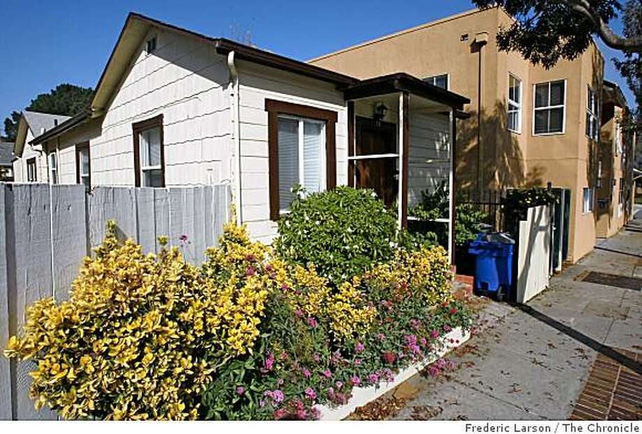 Brisbane, Calif a tiny city of about 3,500 people living on the eastern slope of San Bruno Mountain just off Highway 101 has managed to retain its small-town feel in the midst of the metropolitan Bay Area. Brisbane's downtown lies along a stretch of Visitacion Avenue, between Mariposa Street and Klamath Street has some cute looking cottages in the downtown area on October 29, 2008. Photo: Frederic Larson, The Chronicle