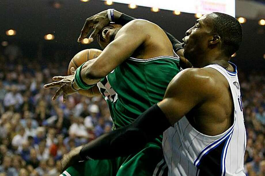 ORLANDO, FL - MAY 18:  Paul Pierce #34 of the Boston Celtics draws contact from Dwight Howard #12 of the Orlando Magic in the second quarter of Game Two of the Eastern Conference Finals during the 2010 NBA Playoffs at Amway Arena on May 18, 2010 in Orlando, Florida. Photo: Kevin C. Cox, Getty Images