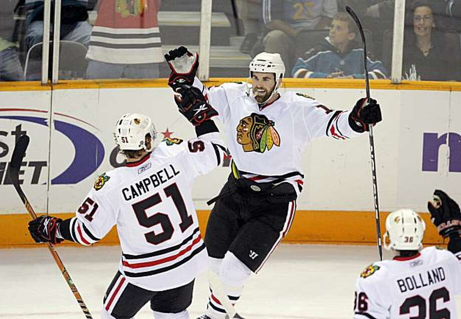 Chicago's Andrew Ladd celebrates his goal with teammates Brian Campbell, left, and Dave Bolland in the first period of Game 2 of the Western Conference Finals in San Jose on Tuesday. Photo: Carlos Avila Gonzalez, The Chronicle