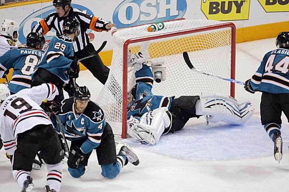 Sharks goalie Evgeni Nabakov is knocked back into the goal in the second period of Game 2 of the Western Conference Finals in San Jose on Tuesday. Photo: Carlos Avila Gonzalez, The Chronicle